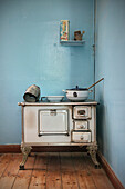 Historical kitchen with cooker in the deserted ghost town in the Diamond restricted area, Kolmanskop near Luderitz, Namibia, Africa