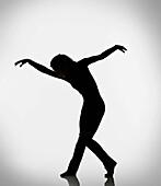 Silhouette of woman dancing