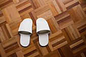 White slippers on wooden floor