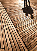 Shadows of two people on boardwalk, Coney Island, New York, USA