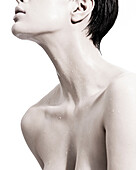 Woman with liquid droplets on neck