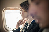 Female passenger looking out of aeroplane window