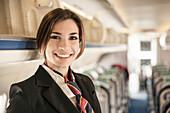 Portrait of air stewardess on aeroplane
