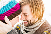 Couple face to face, woman wearing knit hat