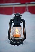An oil lantern lit near the Noorderlicht, a Dutch Schooner. Each year the Nooderlicht is frozen into the ice in Spitsbergen