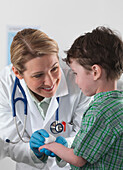 Doctor caring for small boy with injury