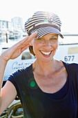 Woman in sailor hat, saluting