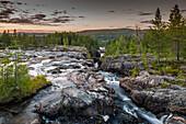 River flowing through gorge, Storforsen, Lapland, Sweden