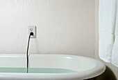 Live plug and cable in bath water