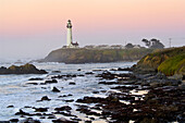 Waves and coastal rocks near Pigeon Point Lighthouse at dawn, San Mateo County coast, California.