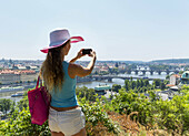 Young caucasian woman 33 years taking pictures of Prague, Czech Republic