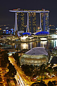 Aerial view of Marina Bay at night. In foreground The Esplanade theatre while in the background the tall towers of Marina Bay Sands. Singapore.