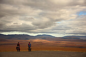 Bikers Taking A Break While Biking The Dempster Highway, Northwest Territories