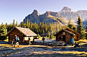 Artist's Choice: Hikers, Elizabeth Parker Hut And Mountains, Yoho National Park, British Columbia