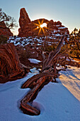 The Setting Sun Seen Through Turret Arch, Arches National Park, Utah.