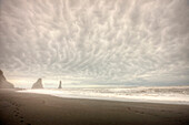 Storm Clouds Over The Ocean And Sea Stacks Near Vik, Southern Iceland