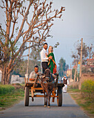 'A Mixed Race Couple Standing In An Embrace On A Cart Being Pulled By A Horse; Ludhiana, Punjab, India'