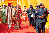 'A Bride And Groom Walk Hand In Hand After Their Indian Wedding Ceremony; Ludhiana, Punjab, India'