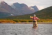 Angler Fly Fishing In Bristol Bay In The Evening Near Crystal Creek Lodge, King Salmon, Southwest Alaska, Summer