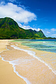 'Water washing up onto the sand along the coast; Wailua, Hawaii, United States of America'