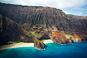'View of a beach along the rugged coast of an hawaiian island; Hawaii, United States of America'