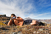 Hiker Stops To Take A Picture Near Noatak River In The Brooks Range, Gates Of The Arctic National Park, Northwestern Alaska, Above The Arctic Circle, Arctic Alaska, Summer.
