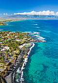 'Aerial view of the North shore coastline, Paia and Kuau towns and West Maui mountains in the distance, Maui, Hawaii, United States of America'