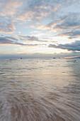 'Sweeping skies and moving water at sunset; Waikiki, Oahu, Hawaii, United States of America'