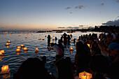 'Annual lantern floating ceremony during sunset at Ala Moana; Oahu, Hawaii, United States of America'