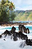 'Waves crash on lava rock at sunrise; Keanae, Maui, Hawaii, United States of America'