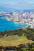 'Kapiolani park and buildings along the coastline; Waikiki, Oahu, Hawaii, United States of America'