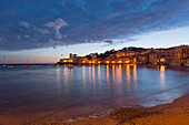 'Buildings Illuminated At Night Along The Water's Edge In Cinque Terre; Sestri Levante, Ligurian, Italy'
