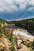 'Sunlight Illuminates The Trout River Flows Over Coral Falls; Northwest Territories, Canada'