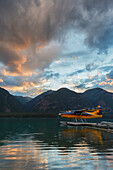 'A Float Plane On Muncho Lake At Sunset; British Columbia, Canada'