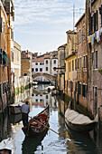 'Gondola In A Canal; Venice, Italy'