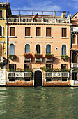 'A Yellow Residential Building Along The Grand Canal; Venice, Italy'
