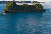 'High Angle View Of Kayaks Paddling In The Coromandel Peninsula To Cathedral Cove; New Zealand'