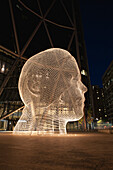 'White Metal Sculpture Of A Head At Night With Lights (Wonderland); Calgary, Alberta, Canada'