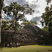 'A Group Of Tourists In A Maya Civilization At Copan Ruins; Copan, Honduras'