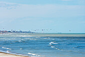 'Kitesurfing In The Distance Along The Coastline; Rimini, Emilia-Romagna, Italy'
