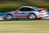 Porsche 997 gt3 on the track with a blurred background, pro'pulsion, driving courses on a race track, dreux, eure-et-loir (28), france