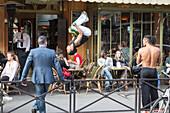 Acrobats at a sidewalk caf?â, avenue de grenelle, 15th arrondissement, paris, france