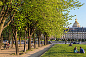 People relaxing on the lawn of the esplanade des invalides, hotel des invalides, 7th arrondissement, paris, france