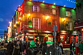 Temple bar, festive ambiance in the evening on temple lane south, dublin, ireland