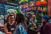 Festive ambiance inside temple bar, temple lane south, dublin, ireland