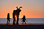 Family having a stroll in cayeux-sur-mer, somme, picardy