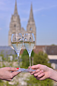 Glasses of white wine with saint-jean-des-vignes abbey in soissons in the background, aisne, picardy, france