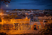 Cagliari at nightfall, graffiti on a wall on a dead-end street, sardinia, italy