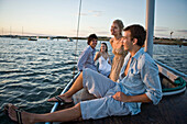 Two Young Couples Relaxing on Sailboat