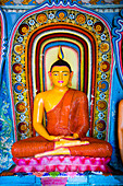 Colourful Buddha statue at Isurumuniya Vihara, Anuradhapura, UNESCO World Heritage Site, Sri Lanka, Asia